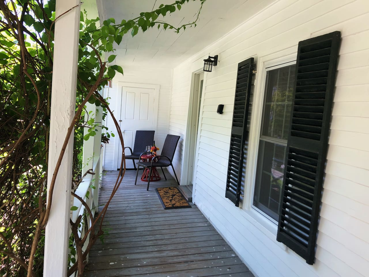 Covered porch makes the apartment feel tucked away and adds extra privacy.