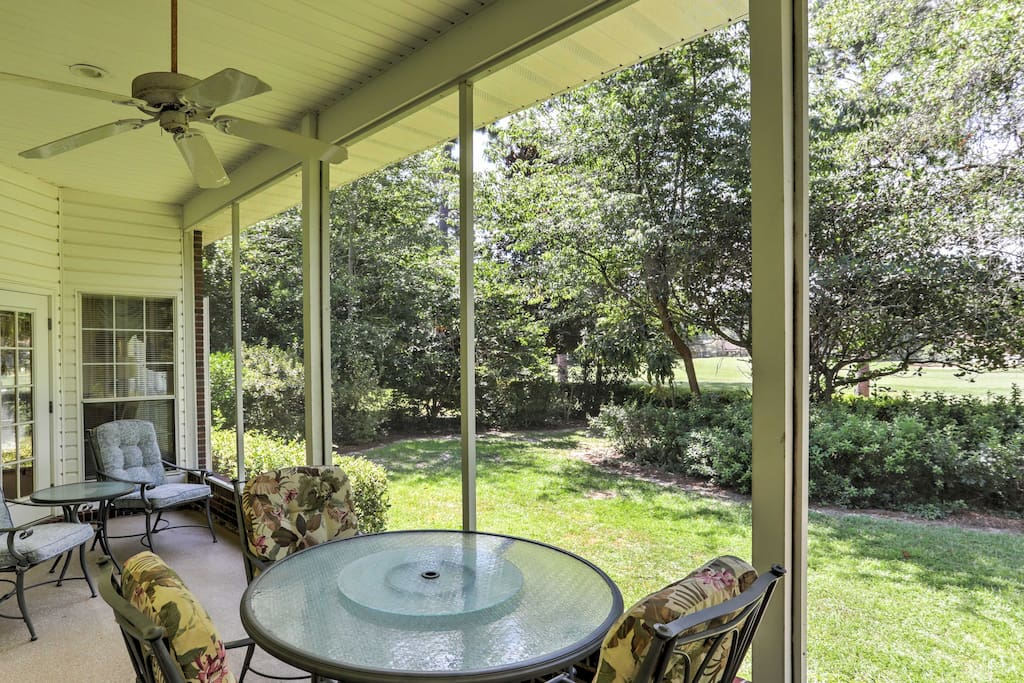 The screened-in porch is great for outdoor dining and offers views of the pristine golf course.