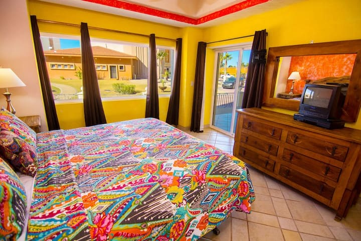 King-sized bedroom leads to outdoor covered patio area.