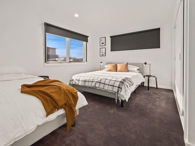 Roomy second bedroom consists of 1 x Queen 1 x Single with built in wardrobe.