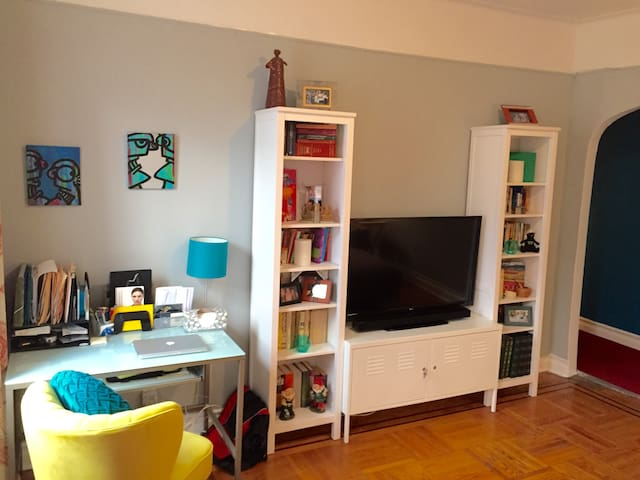 """Desk to work from, book collection, and 42"""" flat screen TV with Cable and Apple TV"""