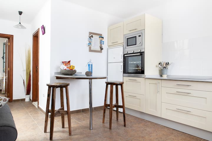 Fully equipped kitchen, and welcome pack for your arrival. Includes water, tea, coffee, crisps, sugar and a cold bottle of Cava.