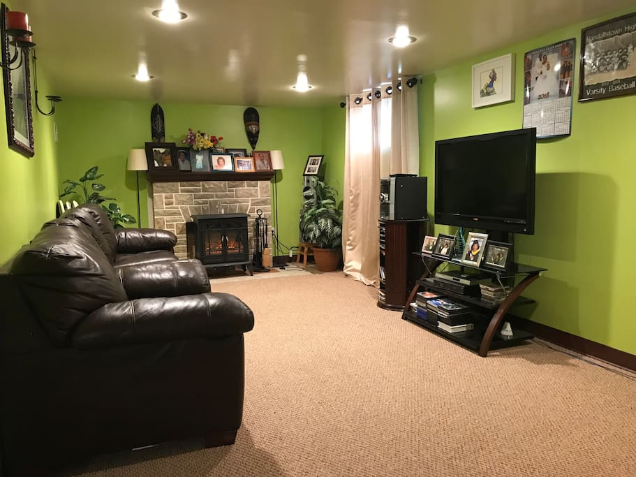 """Large, private den outside the room that's yours to hang out in, watch TV, and get cozy by the space heater """"fire place"""""""