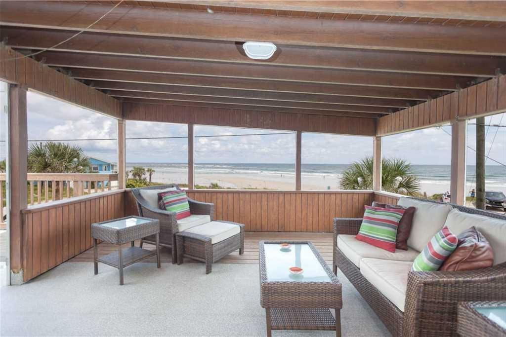 Covered Deck Area - The covered deck area is the perfect spot to enjoy spectacular sunrises with a cup of coffee in hand.  Welcom