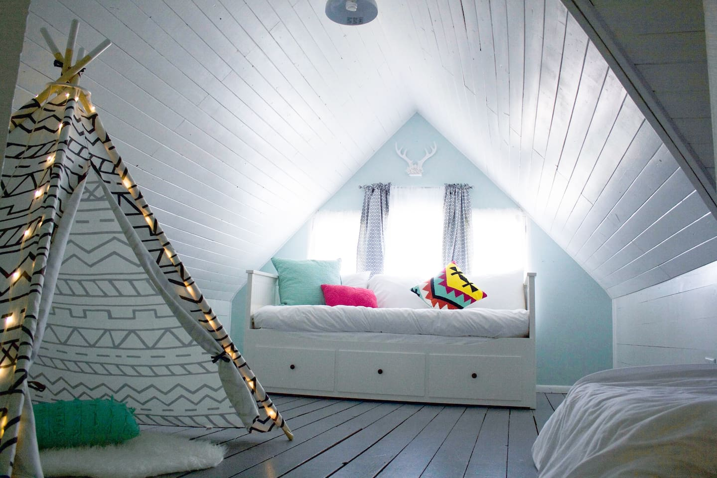 Bedroom #1 - Whimsical attic bedroom with twin daybed that extends into queen size bed, plus 2nd twin memory foam bed, play teepee, and downtown views! (Bedroom #1 and #2 are connected, which can be great for families traveling with children)