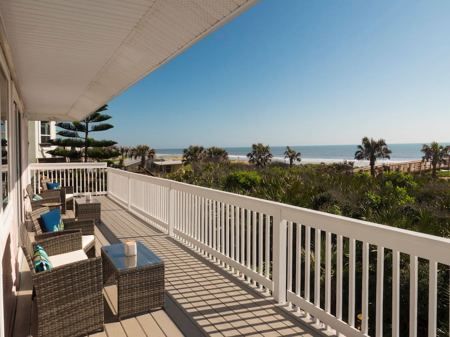 Large back porch with plenty of seating and beautiful beach views.