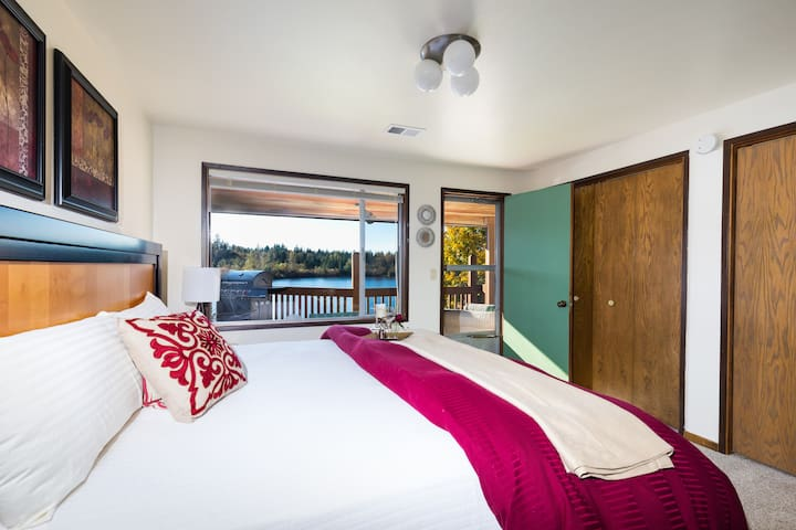 Master bedroom is first on the left with a beautiful King bed. You can see the view with a door to the covered deck.