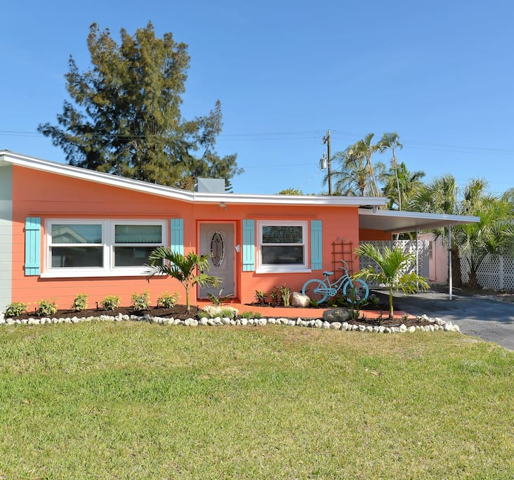 This mid-mod ranch is located in the historic Seaside Gardens neighborhood which came of age in the 1960's. Custom shutters, updated landscaping and bright coastal Florida house colors bring this place to life.