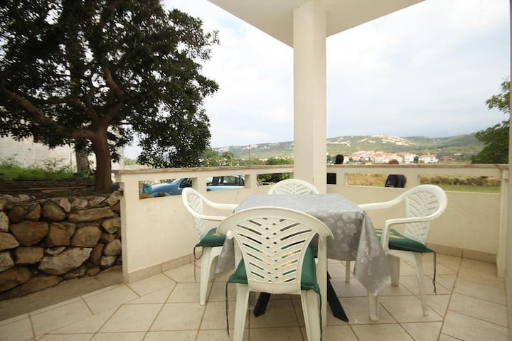 Two bedroom apartment with terrace and sea view Stara Novalja, Pag (A-9416-b)
