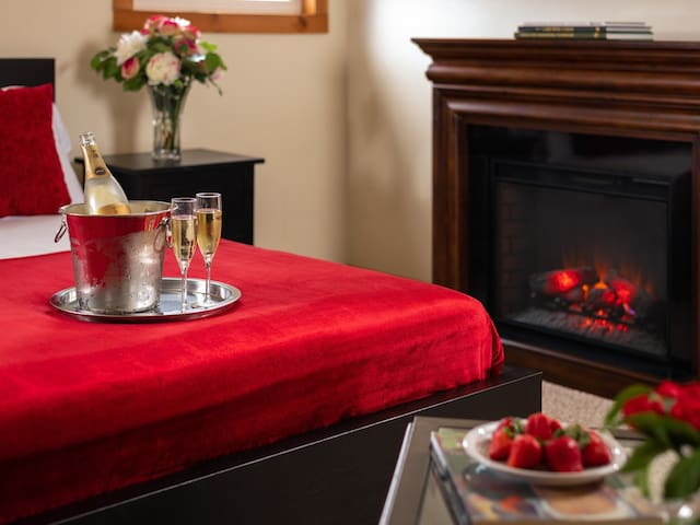 Bedroom with king size bed and electric fireplace for those romantic nights