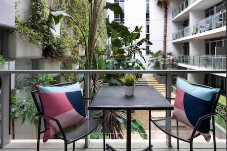 The Iconic, lush garden views, modern space.