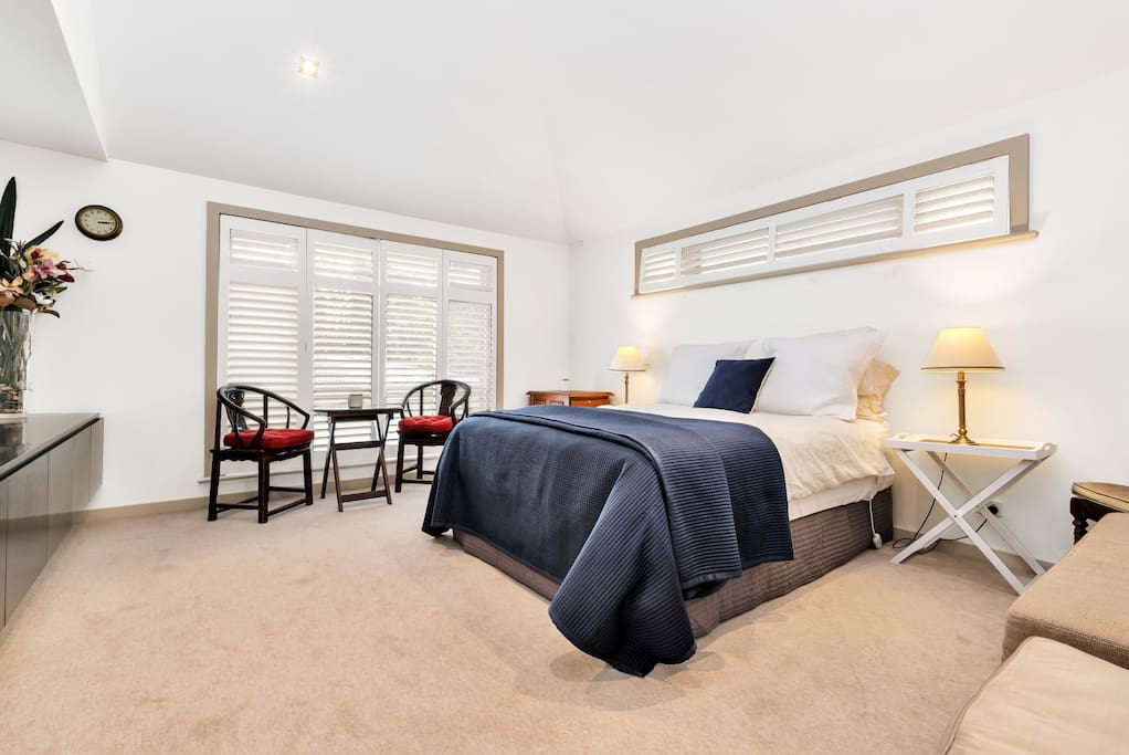 Luxuriously spacious bedroom with queen size bed