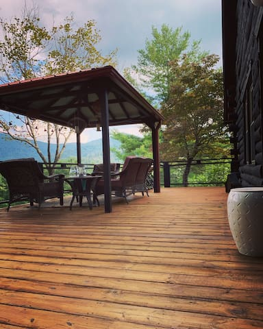 enjoy morning coffee or evening happy hour on the deck overlooking the mountains