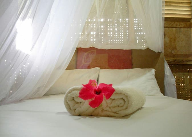 Room is provided with mosquito net, fan, cotton towels and bed linen.