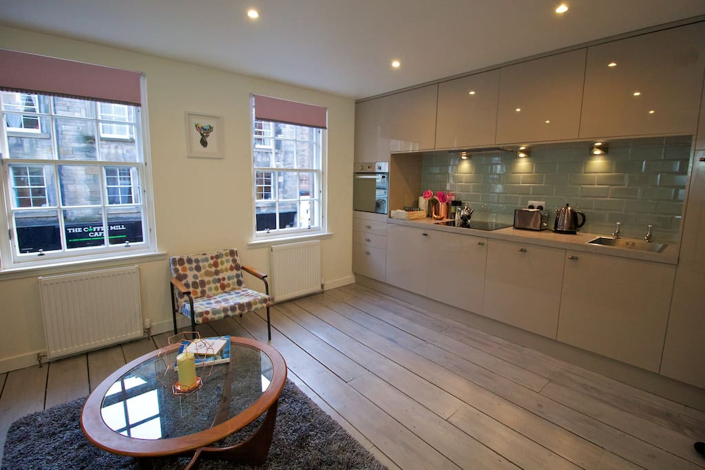 Bright, fully fitted kitchen, lounge area.