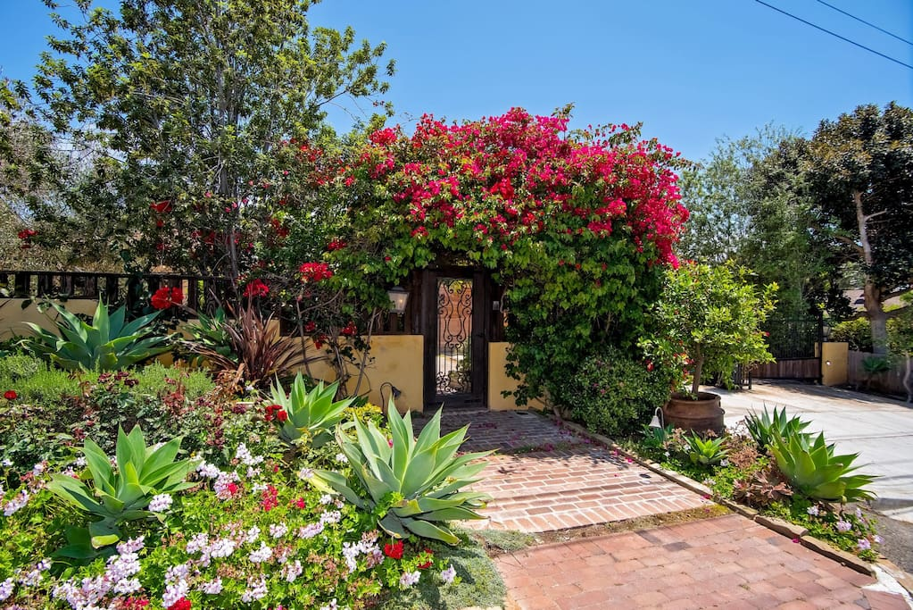 You'll love the gorgeous landscaping and enchanting style of this home!
