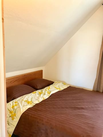 Upstairs bedroom 2. Small but has queen bed.