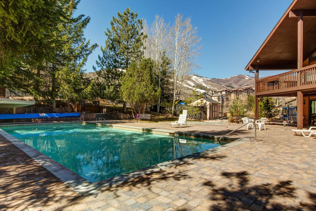 Take a mountain-view dip in the shared pool and shared hot tub!