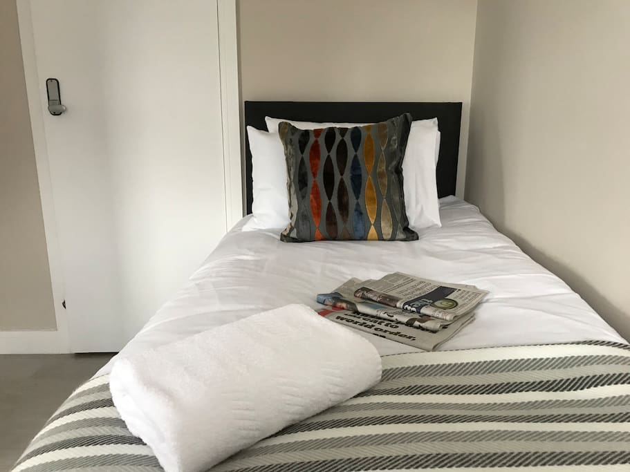 Twin room with fresh, clean linen and towels