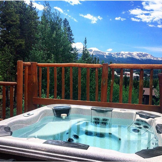 Shared hot tub on The Bivvi deck overlooking Breckenridge mountain.