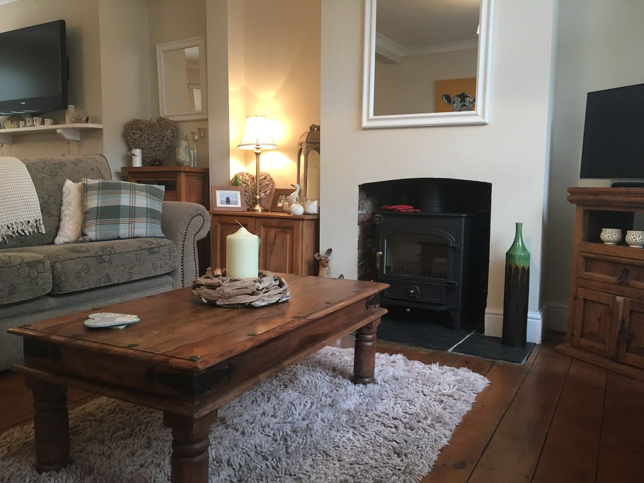 Beautiful cosy lounge, 3 seater and two seater sofas, tv and lovely wood burner