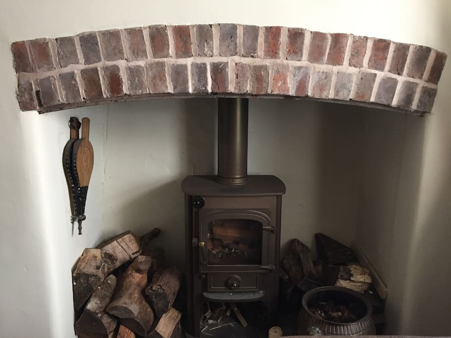 Log burner with a small supply of complimentary logs provided.