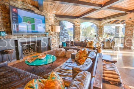 This 18,000sq ft home is prefect for your next vacation. Its sits on 9 acres in north Scottsdale. The pool has a giant resort pool, grotto, and hot tub, Tennis court, shuffle board, putting green an chipping, a giant home theater.