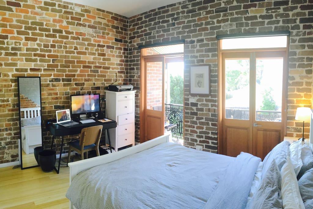 Bedroom, sun-soaked in mornings.