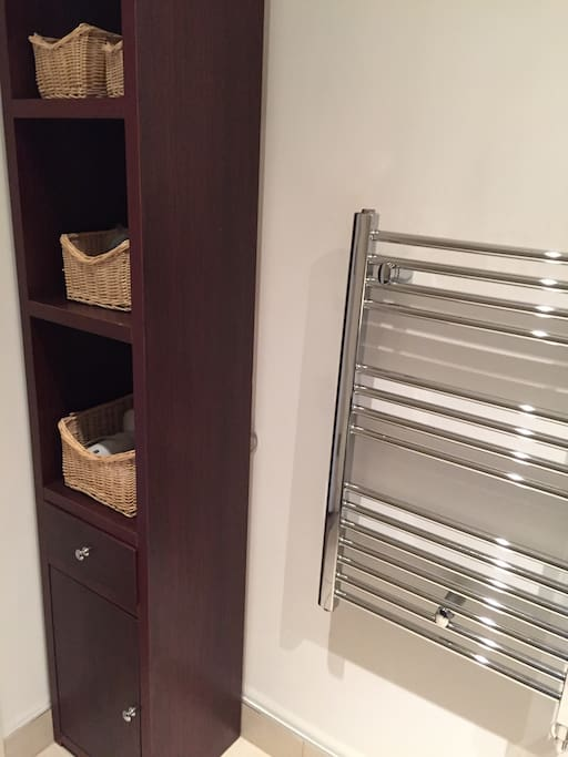 Bathroom cabinet with all necessities for your stay. Heated towel rail