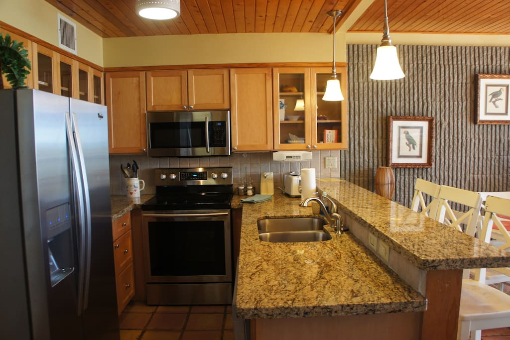Kitchen view with stainless steel refrigerator - Enjoy purified ice and water!