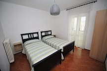 Smaller quiet bedroom with new single beds and furniture.