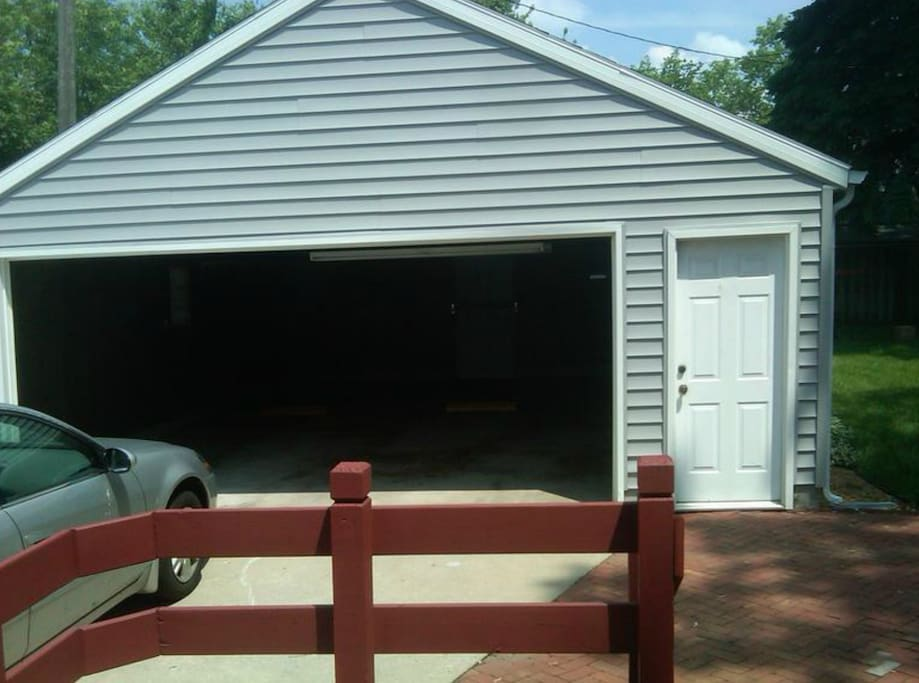 """Deck to Backyard - BBQ Grill and Table on it. Large 2 Car Garage with Storage and Tailgate Accessories (Refrigerator, Tables, Chairs, Ice Chest, Coolers, 32"""" HDTV) for Inclement Weather."""
