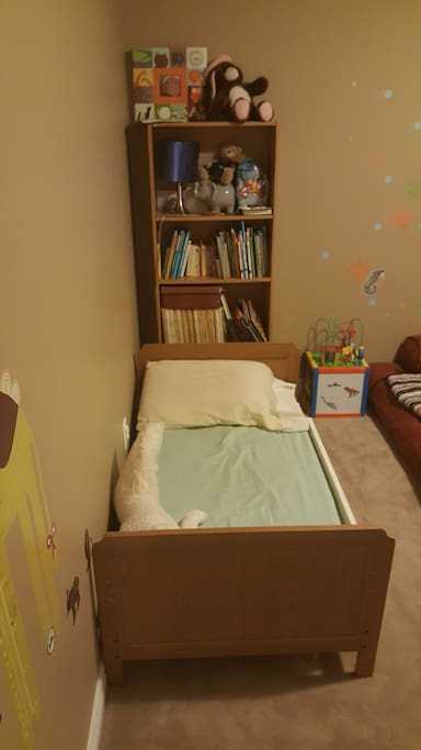Toddler bed in the kids room.