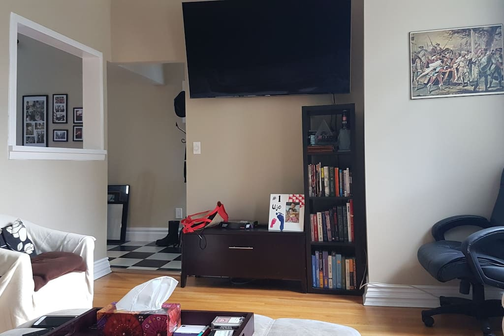 living room again with view of 65 inch tv (netflix and unlimited, ultra-high speed internet included).