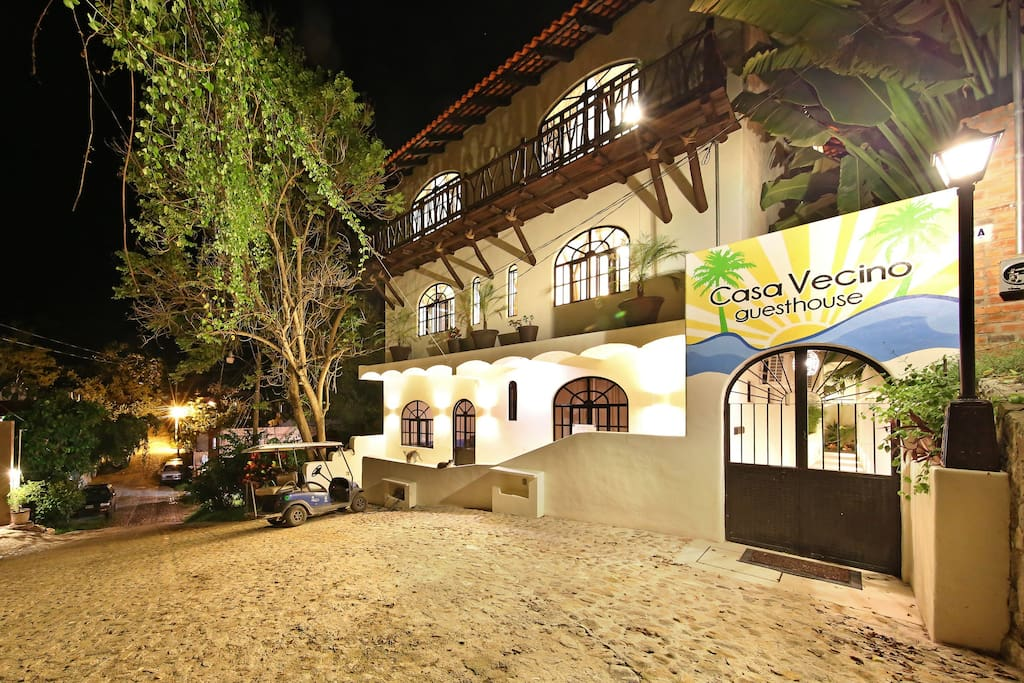 Entrance of Casa Vecino by night.  Our entrance features a secure coded door look and lots of outdoor lighting to help you find your way