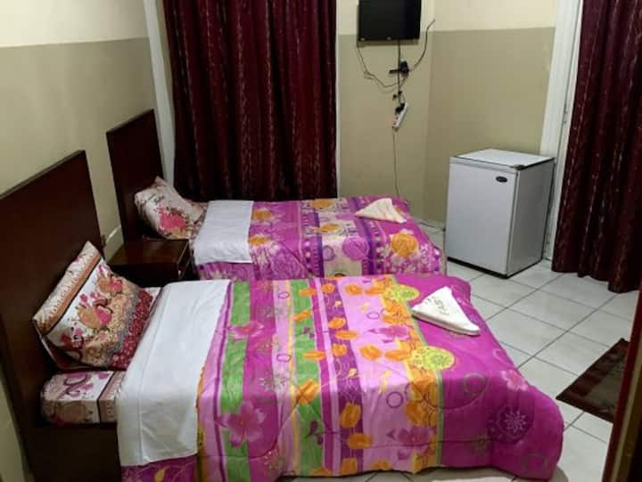 4 single Beds Private Room with Private Bathroom .