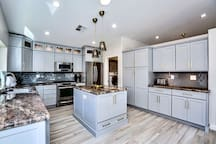 Fully equipped kitchen detailed with stainless steel appliances and granite countertops