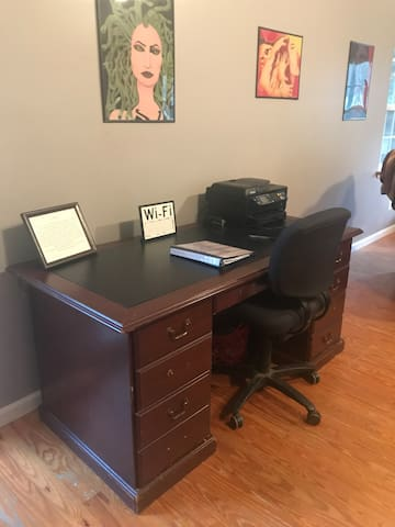 Workspace with printer for guests and local guide book.