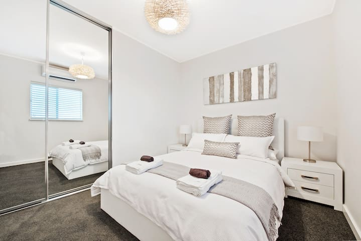 Second Master Bedroom with mirrored wardrobes