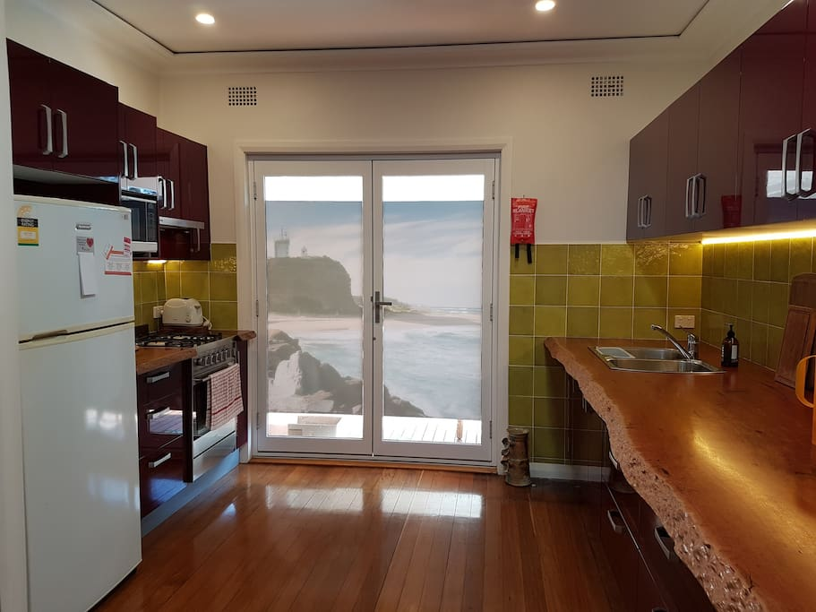 Gourmet kitchen with gas stove and oven, microwave, fridge, and beautiful benches