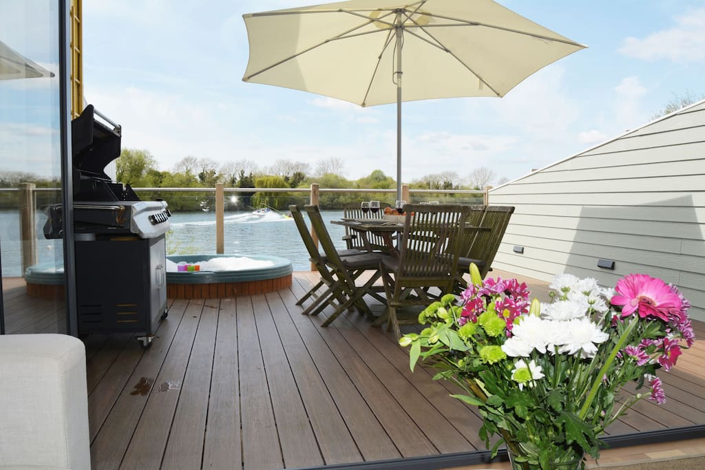 The private deck with hot tub is a perfect spot for alfresco dining or simply to relax