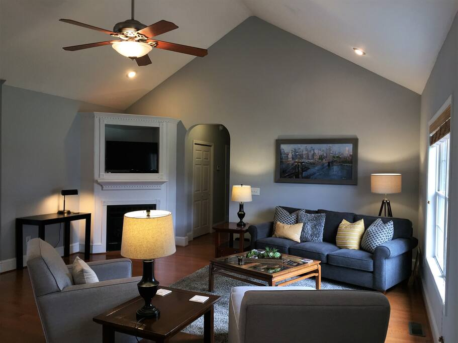 Comfy sitting room with vaulted ceiling, TV, ceiling fan