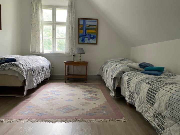 Room 2- Three single beds, garden view.