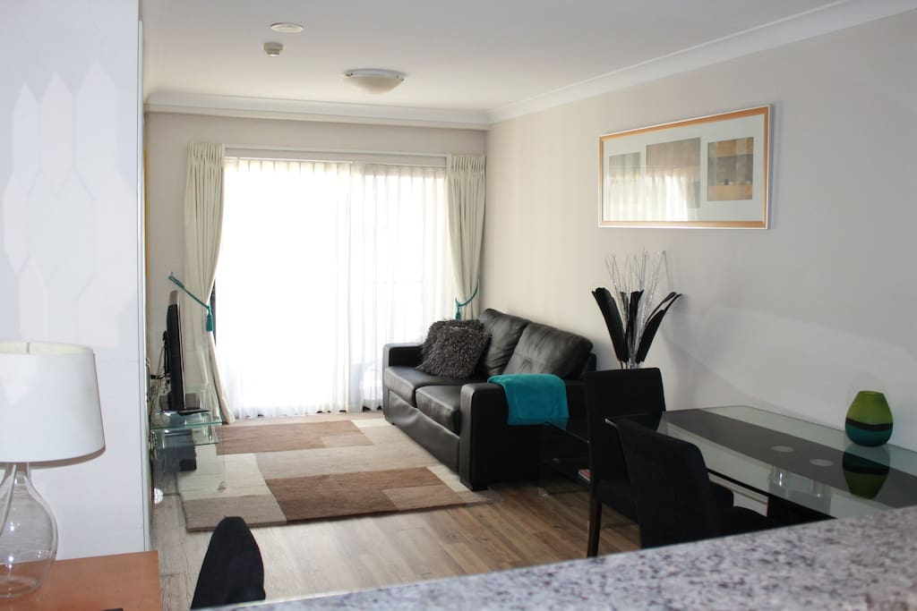 Living area including fold-out sofa bed, study desk and dining table. Fully equipped kitchen. Cable TV.