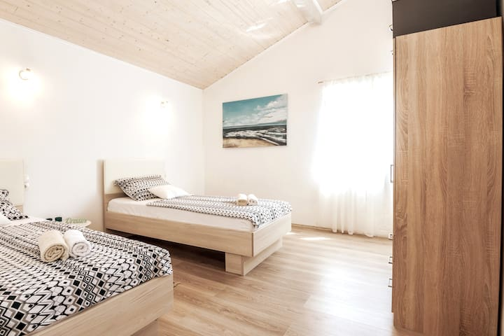2nd bedroom; 2 new comfortable single beds and a large dresser.