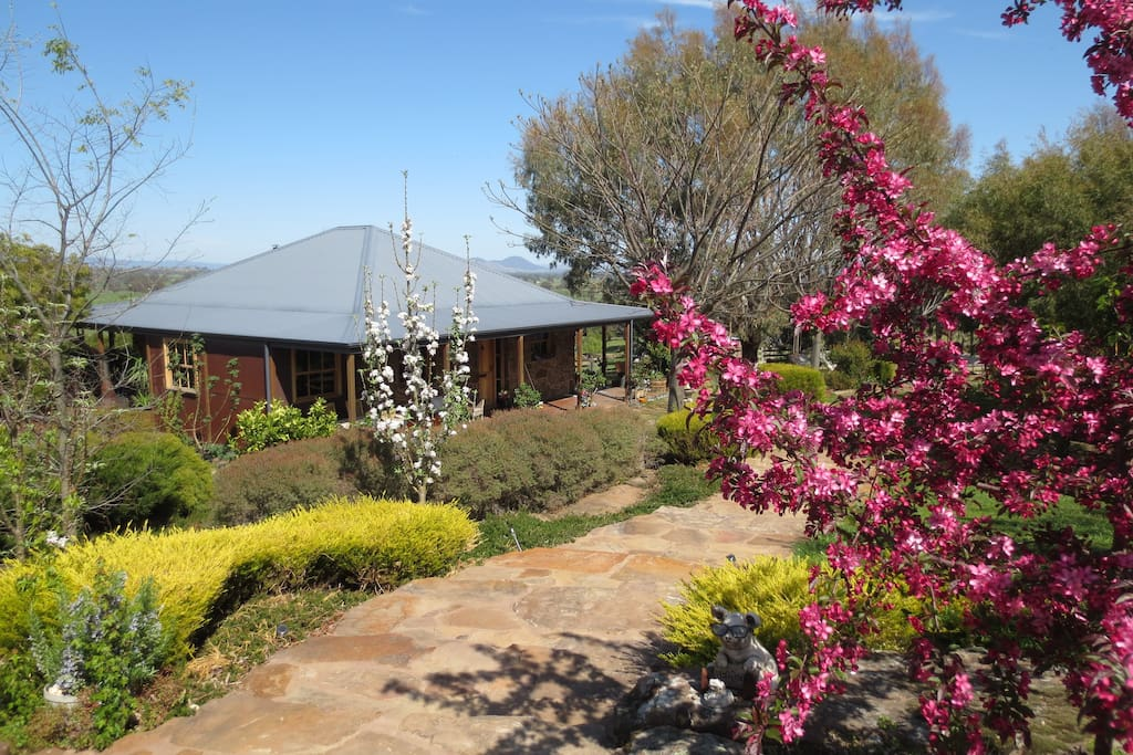 A View to a Hill-Stone Creek Cottage with surrounding established gardens to relax & enjoy
