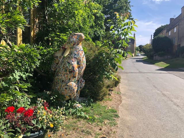 Look for the house with the giant hare