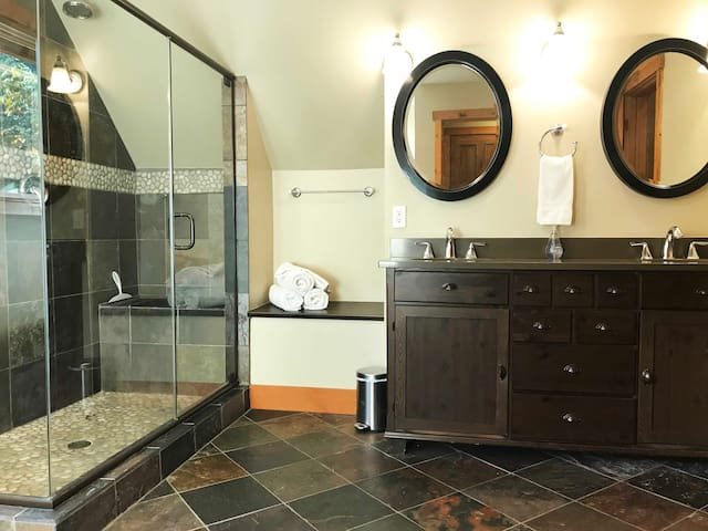 Master Suite private bathroom.  Dual-headed shower enclosure and sinks.  Note:  There is a clawfoot tub (not pictured) but it is currently unavailable for use.  The the water is turned off pending repairs