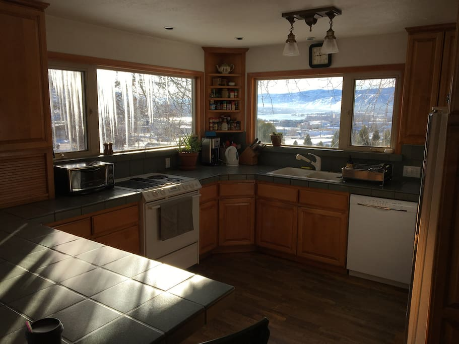 Sunny, fully stocked kitchen has espresso machine, coffee maker, dishwasher, fridge, stove/oven & large counter with 4 stools. You can see our view of the valley through the kitchen windows!