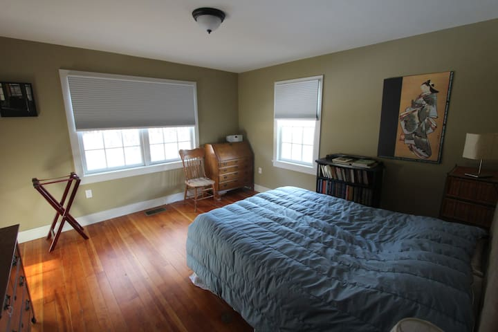 """The """"B"""" or Taupe bedroom with a Queen Bed."""
